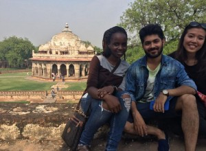 Posing outside Isa Khan's tomb